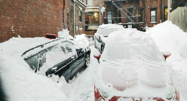 snow-covered cars in Boston