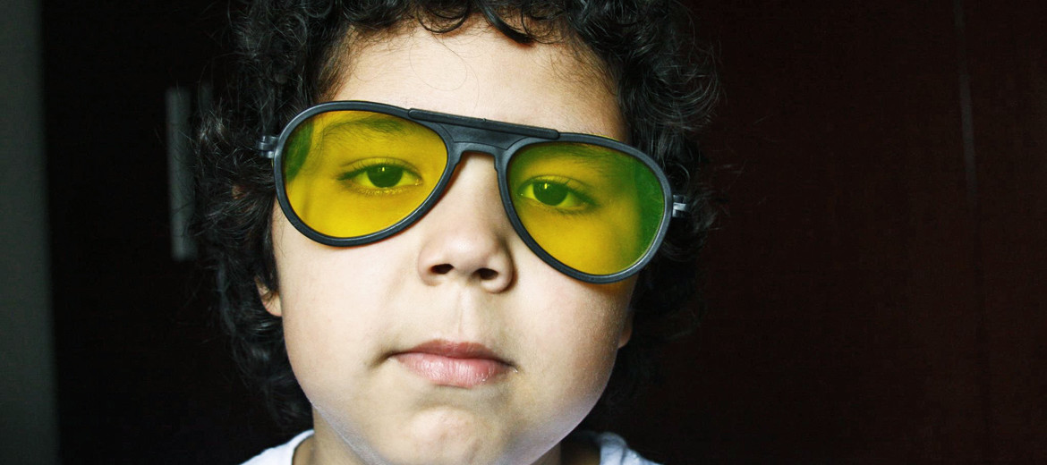 boy wears yellow glasses
