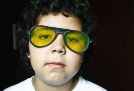 boy wears yellow glasses