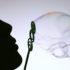 silhouette face blows bubbles