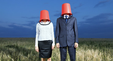 business people with buckets on heads