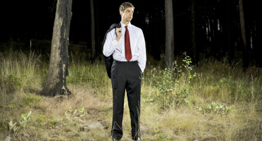 business guy in woods