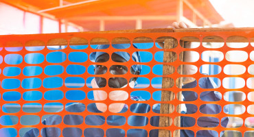 man behind fence at ebola clinic