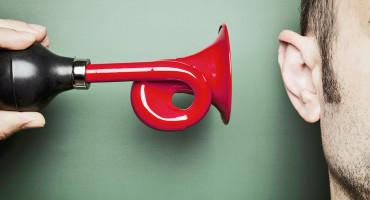horn blowing in a man's ear