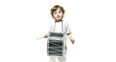 child plays a drum