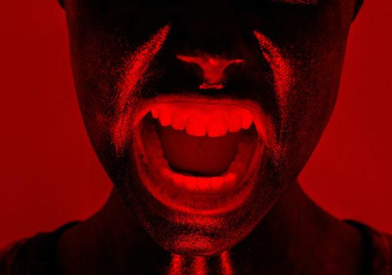 woman screams in red light