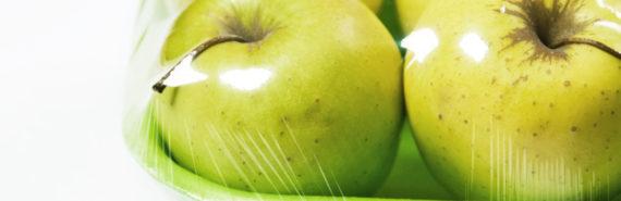 apples in plastic packaging