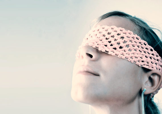 blindfolded woman uses nose