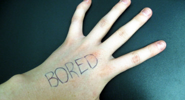 "hand with the word ""bored"""