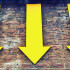 three yellow arrows on brick