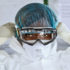 nurse puts on protective gear to treat Ebola patients