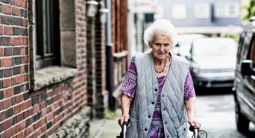 elderly woman on city street