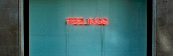 "neon sign says ""feelings"""