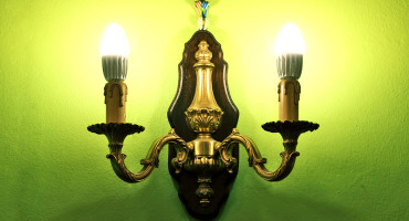 ugly lamp on green wall