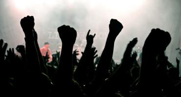 fans' hands at heavy metal concert