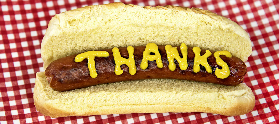 "mustard ""thanks"" on hotdog"