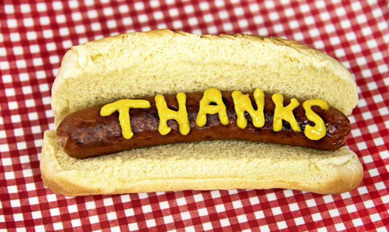 "mustard ""thanks"" on hotdog"
