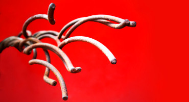 metal tentacles on red