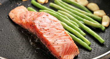 salmon and vegetables in pan
