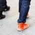 heels and sneakers on sidewalk