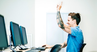 tattooed guy at computer