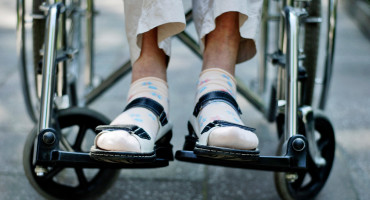 elderly person's feet on wheelchair
