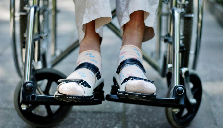 elderly person's feet on wheelchair