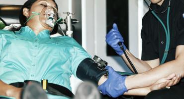 paramedic assists a woman