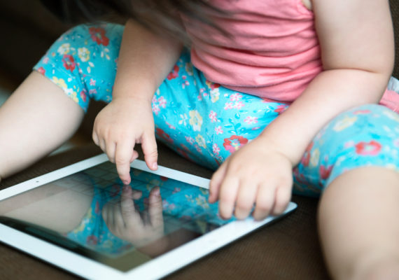 baby uses tablet/iPad