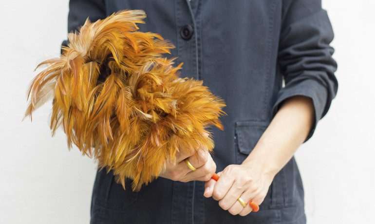 Woman holding a feather duster
