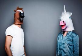 couple wearing horse head masks