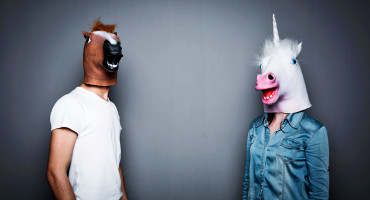 couple wearing horse head masks