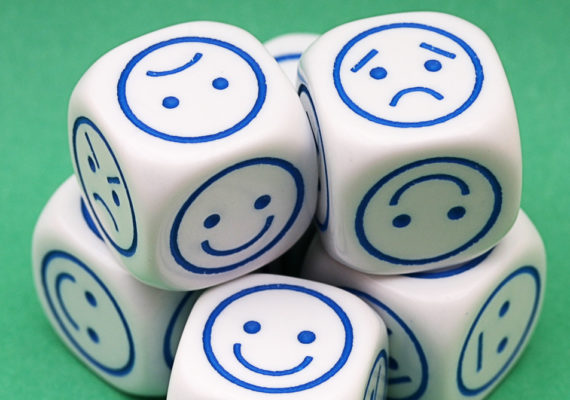 dice with mixed emotions