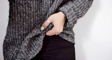 woman nervously tugs sweater