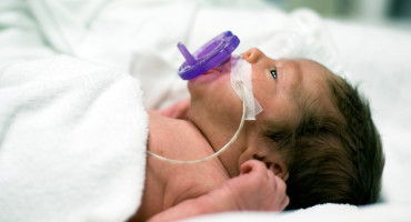 premature baby with pacifier