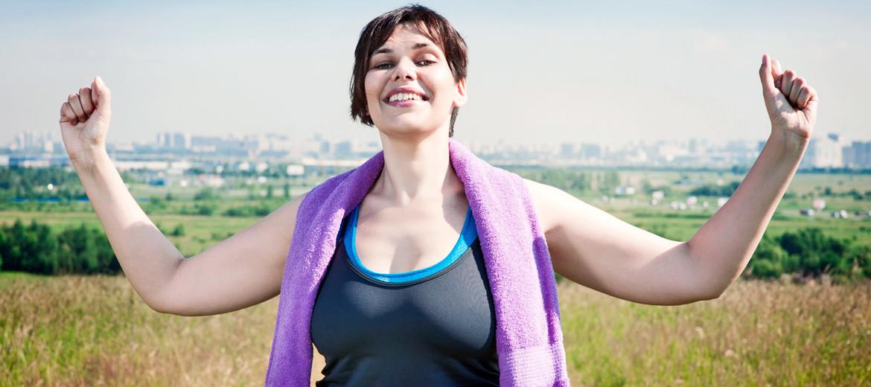 exercising woman looks triumphant