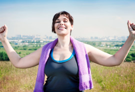 exercising woman looks triumphant