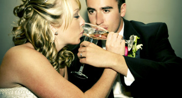 wedding couple sips champagne