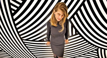 woman looks up from swirly wall