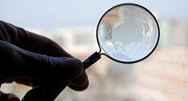 magnifying glass of globe