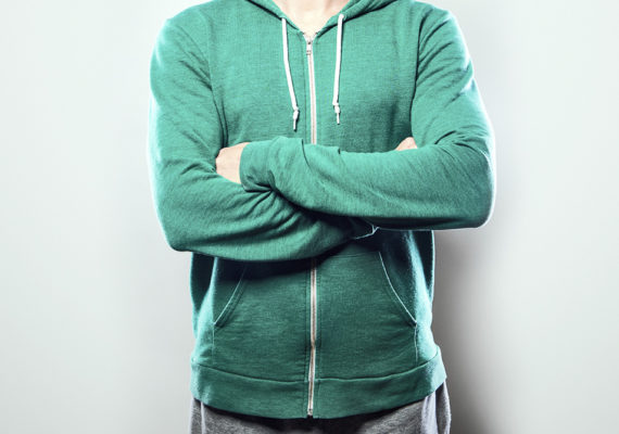 man with arms folded