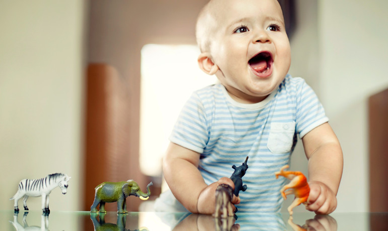 baby with toy animals