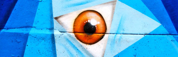 eye in blue triangles