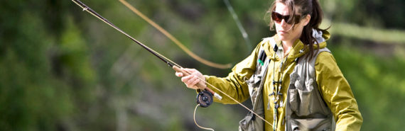 woman fly fishing for trout
