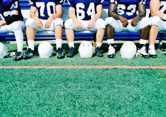 football players on bench