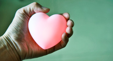 glowing heart in hand