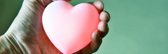 glowing heart in hand