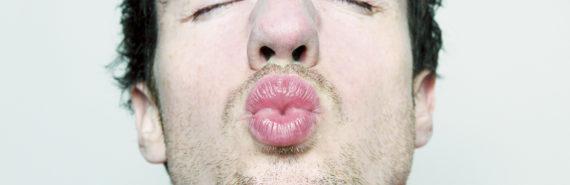 man makes a kissy face