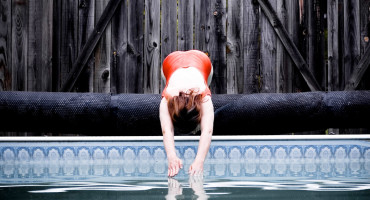 woman dives into pool