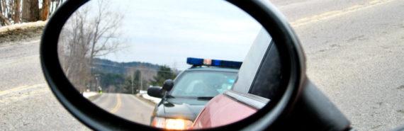 police car in car mirror
